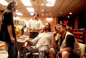 "From left:  JIMMY DALE GILMORE as Smokey, STEVE BUSCEMI (background) as Donny, JEFF BRIDGES as The Dude and JOHN GOODMAN as Walter in ""The Big Lebowski,"" a Jel and Ethan Coen film released by Gramercy Pictures."